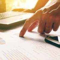 hands and financial documents
