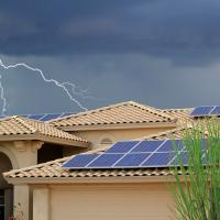 solar panels on a roof during a storm with lightening