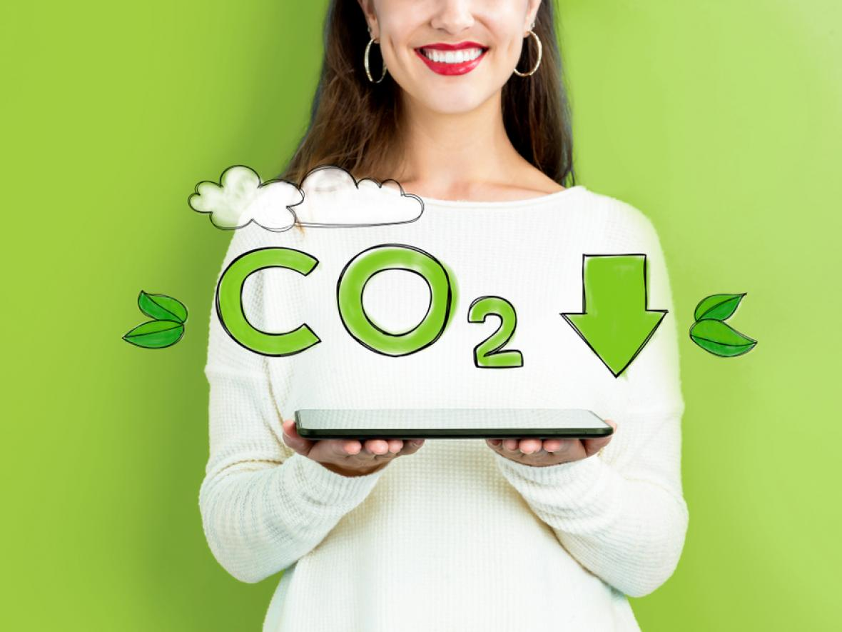 woman holding tablet, awareness about reducing CO2