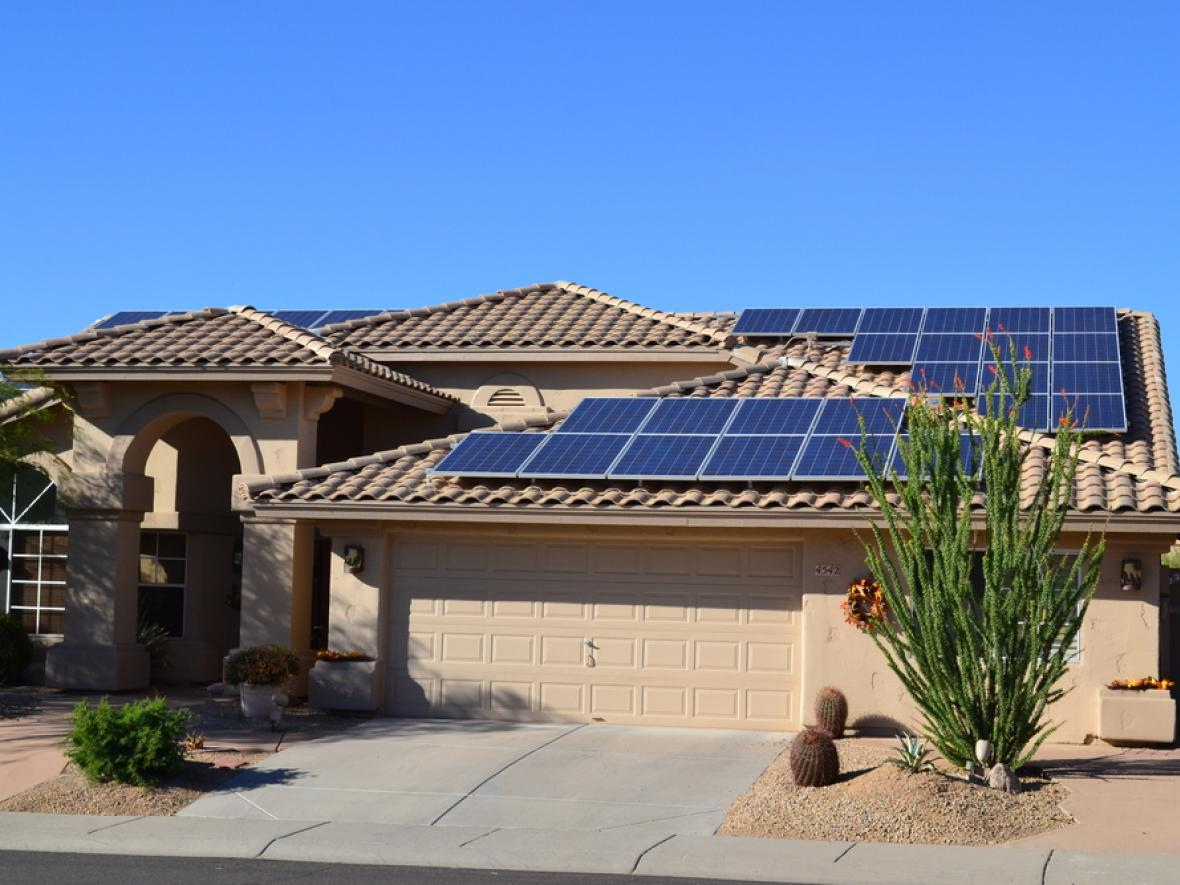 Ranch house with solar panels on the roof