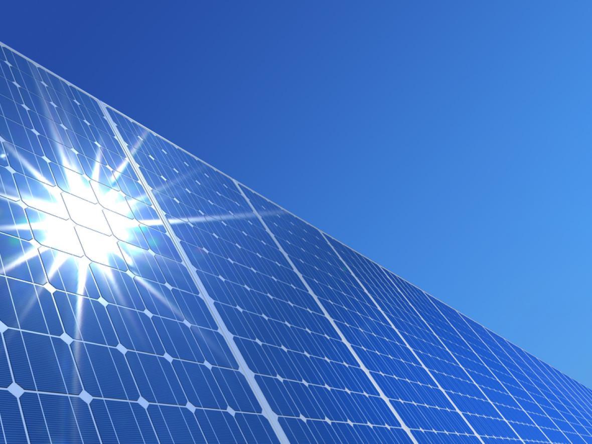 solar panels with sun shining on them