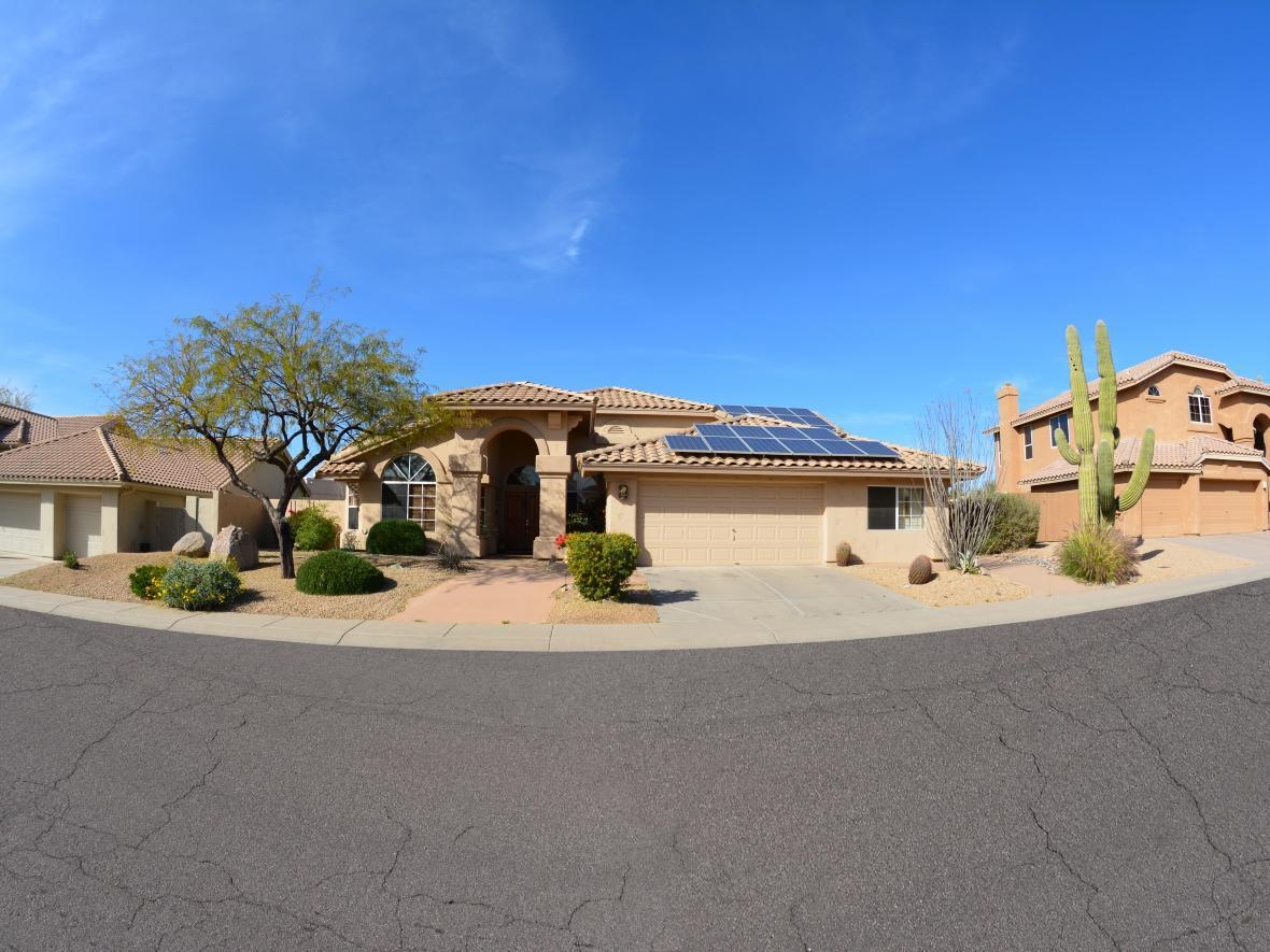 street view of home with solar power