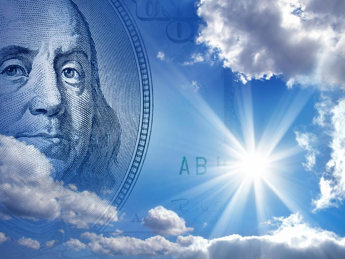 Ben Franklin $100 bill in blue sky solar