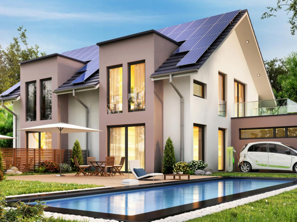 modern house with smart car and solar panels
