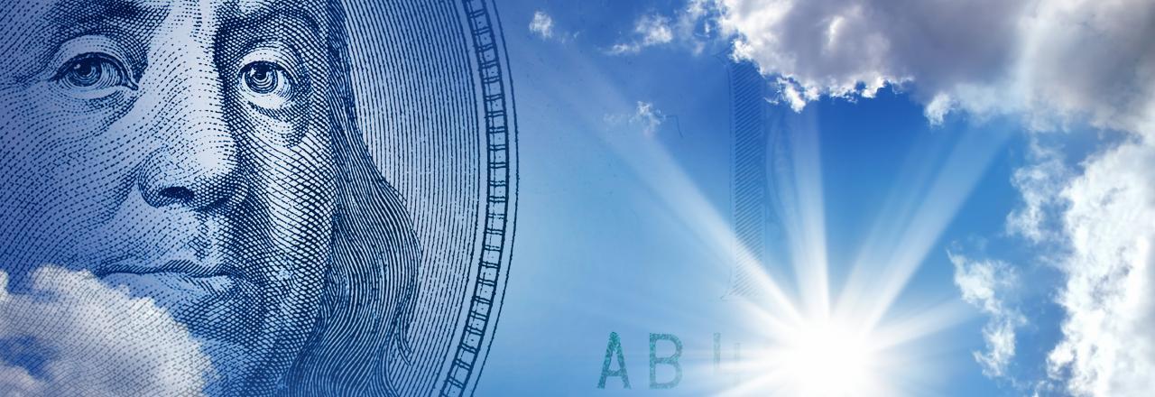Ben Franklin $100 bill in blue sky solar