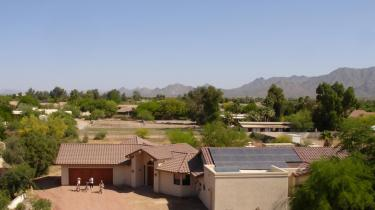 aerial view of AZ house with solar panels against mountain view