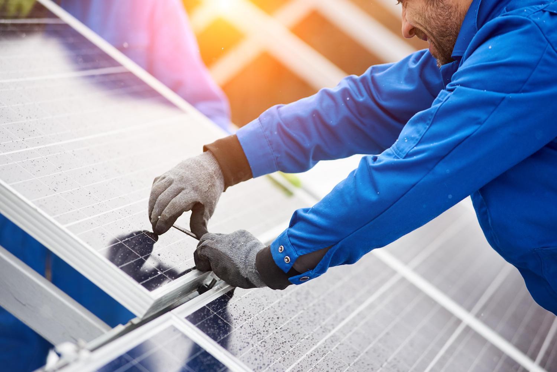 tech installing solar panel